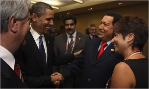 Obama and Chavez shake hands