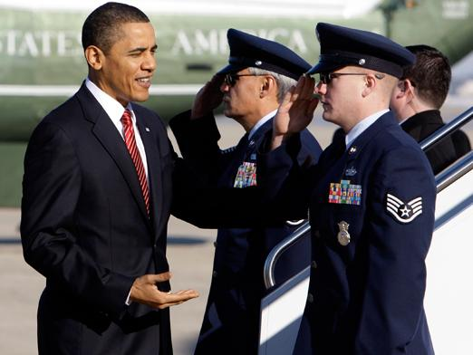 President Barack Obama reaches to shake hands before boarding Air Force One at Andrews Air Force Base. AP